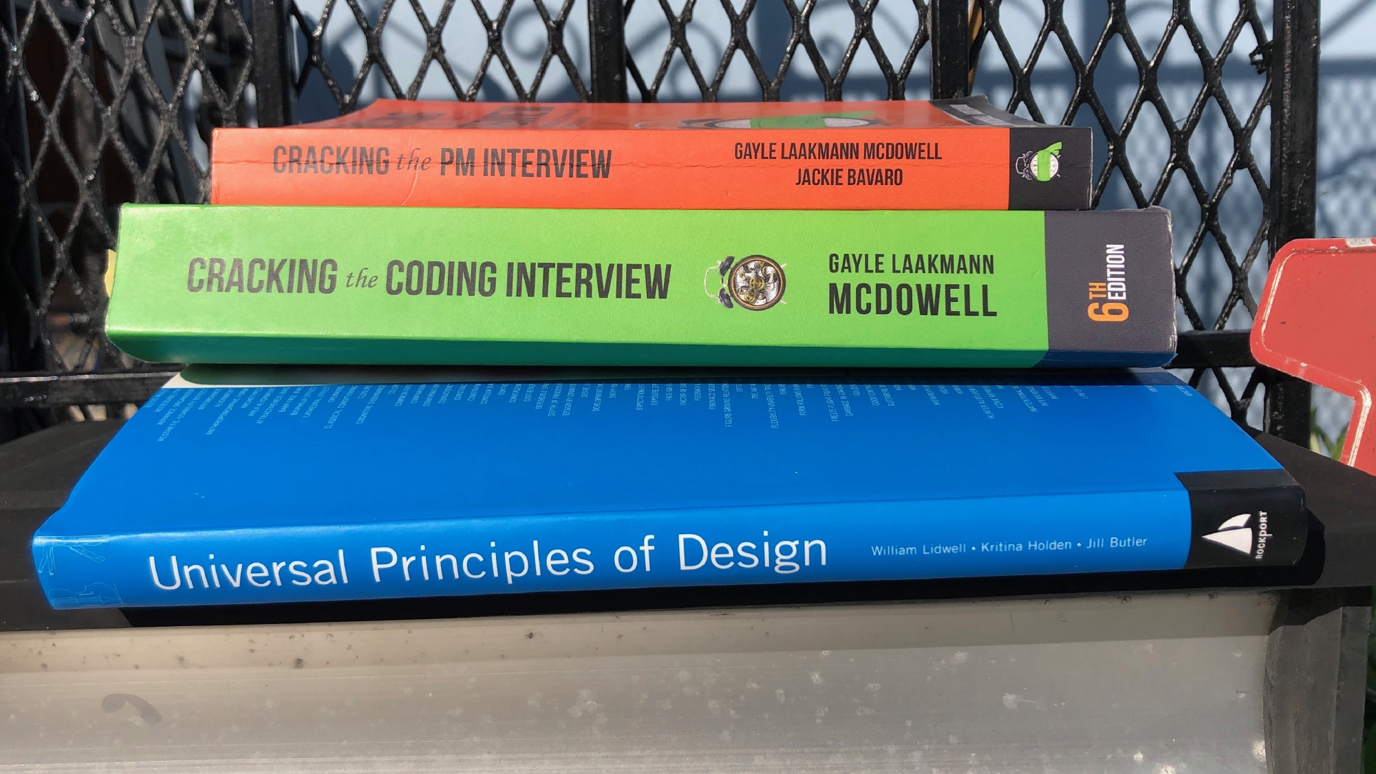 A stack of tech interview books being given away